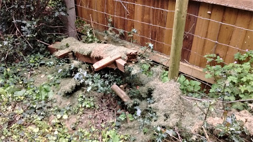 HO8 fence debris and garden rubbish dumped along the path